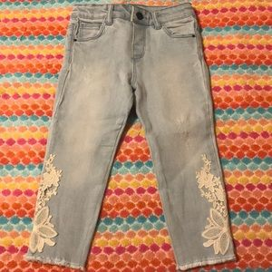 Jeans with embroidery on legs